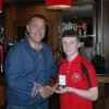 U14's Captain Ciaran Wilson with Club sponsor Paul Davidson of NK Group