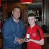 U14's Captain Ciaran Wilson with Club sponsor Paul Davidson of NK Group