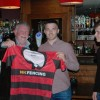 U18's Captain John Stewart presents a 150th shirt to coach Jimmy McTeggart