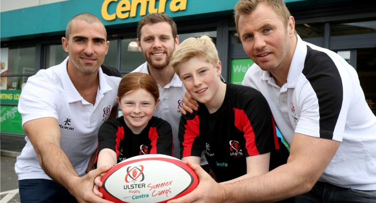 13 April 16 - Picture by Darren Kidd / Press Eye. Ulster Rugby stars Darren Cave, Roger Wilson and Ruan Pienaar help young players Nathan and Abi Toland from Carrickfergus kick-off the 2016 Centra Ulster Rugby Summer Camps. The camps, sponsored by the local convenience brand and its independent retailers, will take place in over 20 venues across Ulster from July 4 Ð August 25. The camps offer boys and girls from 6-18 years the chance to experience rugby for the first time as well as developing their skills and this year will introduce School of Excellence sessions for youth players aged 13-17 years. For full details and how to book a place visit camps.ulsterrugby.com